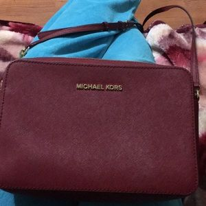 Burgundy Michael Kors crossbody purse